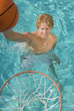 Man Playing Water Basketball Stock Image