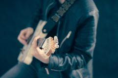 Man Playing White Electric Guitar Stock Photo