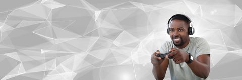 Man Playing With Computer Game Controller With Bright Polygon Background Stock Photo