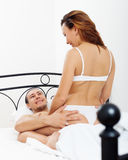Man playing with woman in bed Stock Photo