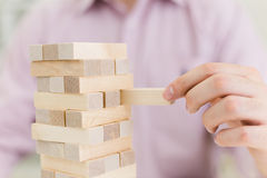 Man playing with wooden blocks royalty free stock image