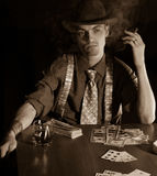 Man playng card game Royalty Free Stock Photos
