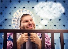 Man in playpen is daydreaming Stock Photo