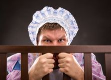Man in playpen looking out Royalty Free Stock Photos