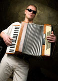 A man plays the accordion. In the club royalty free stock photos