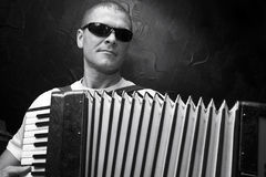 A man plays the accordion Royalty Free Stock Image
