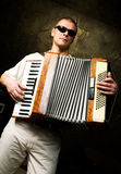 A man plays the accordion Stock Image