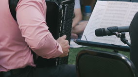 A man plays the accordion. stock footage