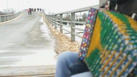 Man plays the accordion on pedestrian bridge stock footage
