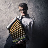 Man plays the accordion. Temperamental man plays the accordion royalty free stock image