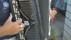 Man plays the accordion video stock footage