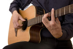 Man plays acoustic guitar. Man plays 6-strings acoustic guitar Royalty Free Stock Image