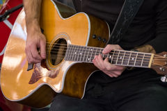 Man plays acoustic guitar Stock Photography