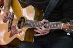 Man plays acoustic guitar Stock Photo