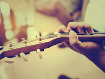 A man plays an acoustic guitar close-up Royalty Free Stock Images