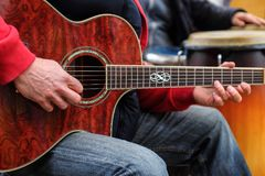 Man plays on acoustic guitar - Guitar player Stock Image