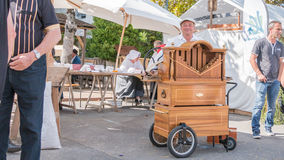 Man plays the barrel organ in the street. Challans, France - August 11, 2016 : event Once Challans Autrefois Challans organized by the city and plunges visitors stock photography