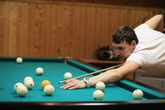 Man plays billiards Royalty Free Stock Photos
