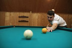 Man plays billiards Royalty Free Stock Image
