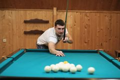 Man plays billiards Stock Images