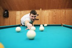 Man plays billiards Stock Photo