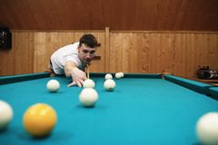 Man plays billiards Stock Image
