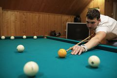 Man plays billiards. And takes aim before the turnr Stock Images
