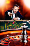 Man plays casino Royalty Free Stock Photos