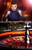 Man plays casino Stock Photo