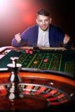 Man plays casino Stock Photos