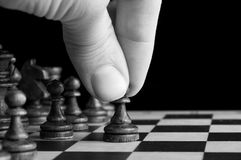 Man plays chess Stock Photography