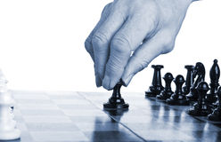 Man plays chess Stock Images