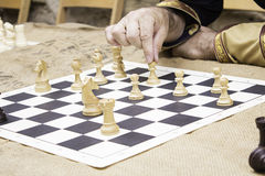 Man plays chess Stock Photo