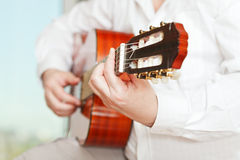 Man plays on classical acoustic guitar. Close up Stock Images