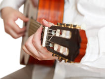 Man plays on classical acoustic guitar isolated. Man plays on classical acoustic guitar close up isolated on white background Stock Image