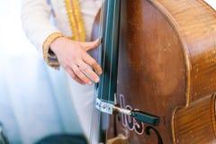 The man plays a contrabass. Stock Image