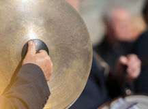 Man plays the cymbals Stock Image