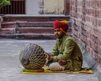 A man plays drum at Mehrangarh Fort royalty free stock photography
