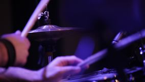 Man plays drums close-up. Man playing drums in concert close-up stock video footage