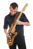 Man plays electric guitar Royalty Free Stock Image