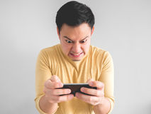 Man plays game furiously. stock images