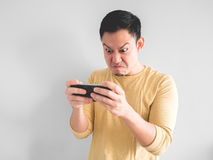 Man plays game furiously. stock photography