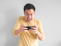 Man plays game furiously. royalty free stock image