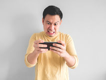 Man plays game furiously. royalty free stock photo