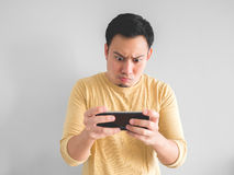 Man plays game seriously. stock photography