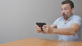 Man plays a game on the tablet stock video footage