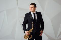 A man plays the saxophone close up stock images
