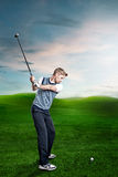 Man plays Golf. On the golf course Royalty Free Stock Photography