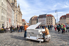 Man plays on a grand piano on Neumarkt square in Dresden Stock Photos