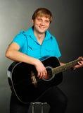 Man plays guitar Royalty Free Stock Image
